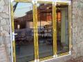 Двери гармошки Alumil